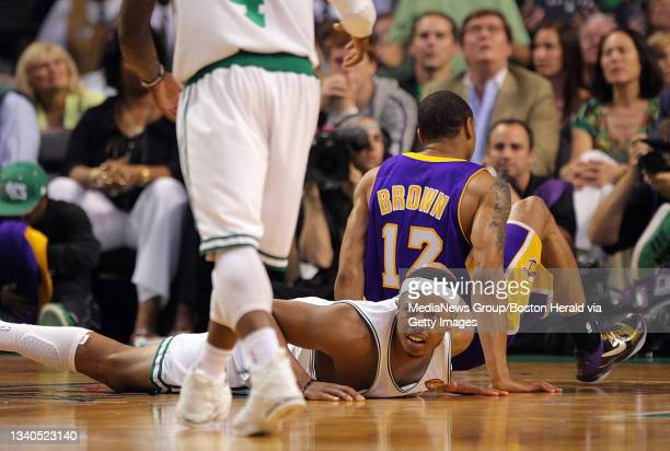 Boston Celtics forward Paul Pierce on the floor after colliding with Los Angeles Lakers guard Shannon Brown during the second quarter of the NBA...