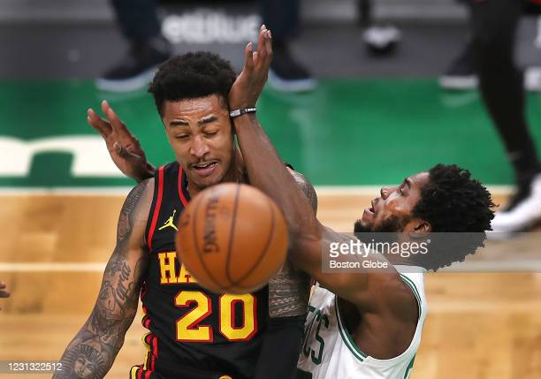 Boston Celtics forward Semi Ojeleye collides with Atlanta Hawks forward John Collins as Collins makes a first quarter pass. The Boston Celtics host...