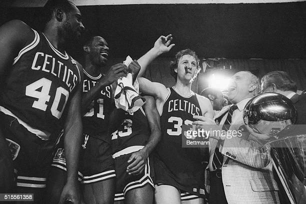 Boston Celtics general manager Red Auerbach laughs after Larry Bird stole his cigar during a victory celebration, after the Celtics beat the Houston...
