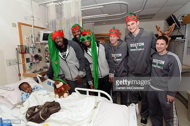 Boston Celtics Gerald Wallace Walter McCarty Marcus Smart Jay Larranaga Tyler Zeller and Darren Erman spend time with David at Boston Children's...