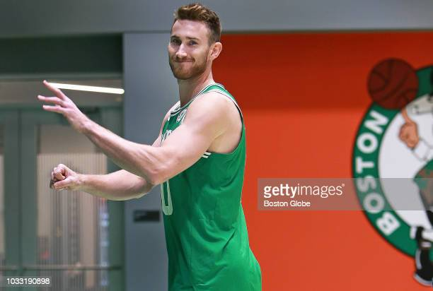 Boston Celtics' Gordon Hayward smiles and waves following a photo shoot after meeting with the media at the team's practice facility in the Brighton...