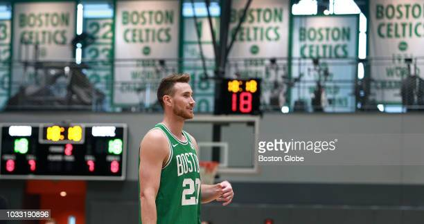 Boston Celtics' Gordon Hayward walks across the floor in uniform following a photo shoot after meeting with the media at the team's practice facility...