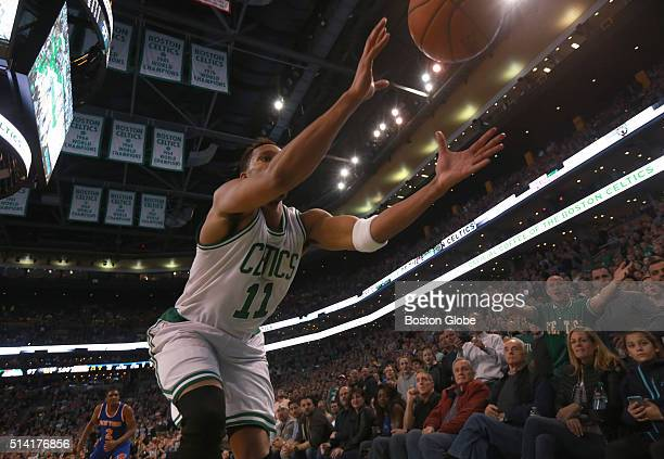 Boston Celtics guard Evan Turner dives into the court side seats to keep the ball in play on a big play during the fourth quarter during a game...