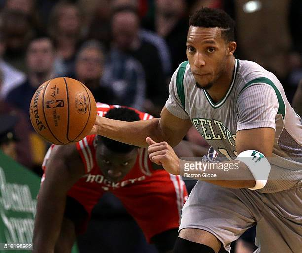 Boston Celtics guard Evan Turner heads up court after picking off a Houston Rocket pass during the first quarter of a game at TD Garden in Boston on...