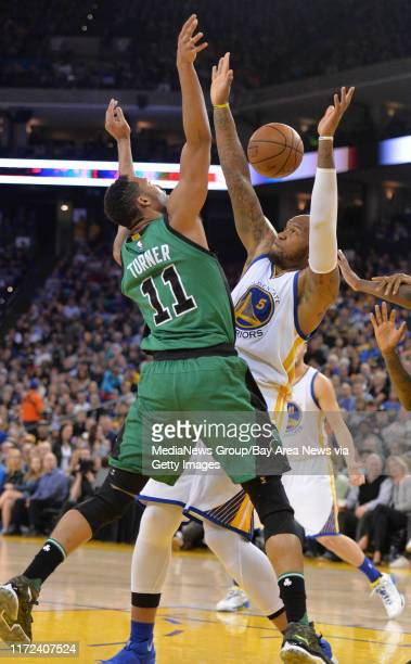 Boston Celtics guard Evan Turner is blocked by Golden State Warriors forward Marreese Speights in the second quarter of their basketball game at...