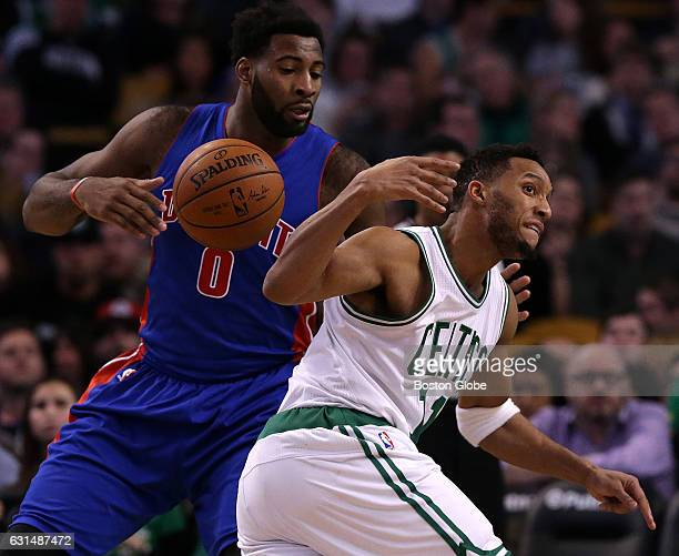 Boston Celtics guard Evan Turner is stripped of the ball as he tries to drive around Detroit Pistons center Andre Drummond during the third quarter...
