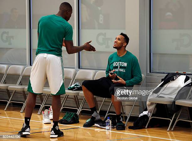 Boston Celtics guard Evan Turner right and guard Terry Rozier chat as they arrive to practice at Georgia Tech in Atlanta on April 17 as they prepare...