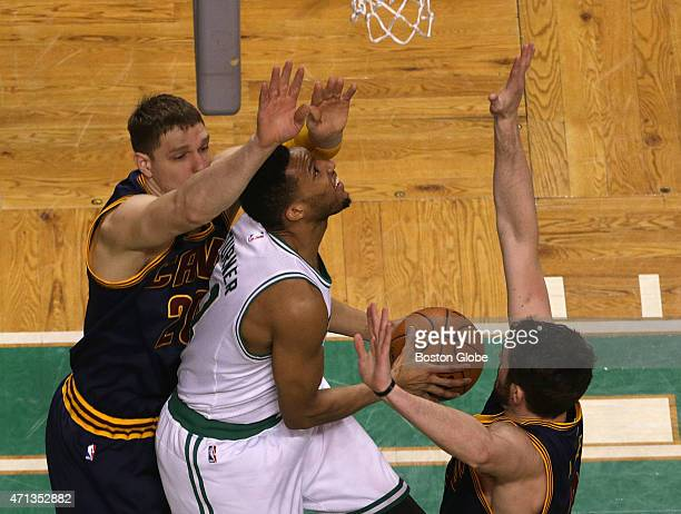 Boston Celtics guard Evan Turner split the Cleveland Cavaliers defense as he goes for a reverse layup during the first quarter The Boston Celtics...