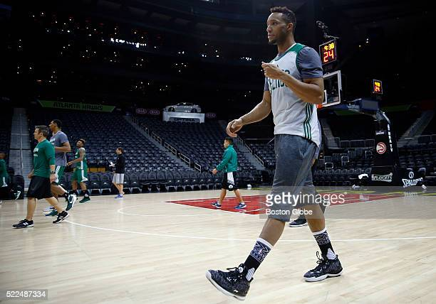 Boston Celtics guard Evan Turner stretches with teammates before the start of practice at Philips Arena in Atlanta on April 18 as they prepare for...