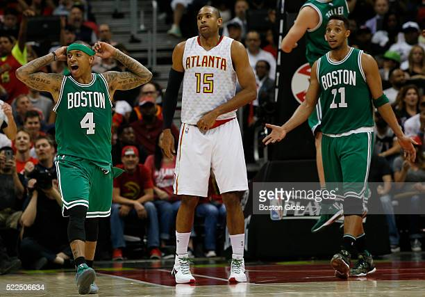 Boston Celtics guard guard Isaiah Thomas left reacts after he is called for fouling Atlanta Hawks forward Thabo Sefolosha not pictured on a three...