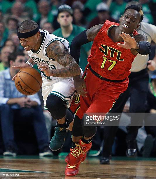 Boston Celtics guard Isaiah Thomas and Atlanta Hawks guard Dennis Schroder battle in the fourth quarter hitting the floor after they collided in Game...