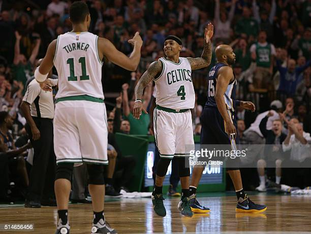 Boston Celtics guard Isaiah Thomas and Boston Celtics guard Evan Turner celebrate after Thomas's three pointer with 124 left in the third quarter a...