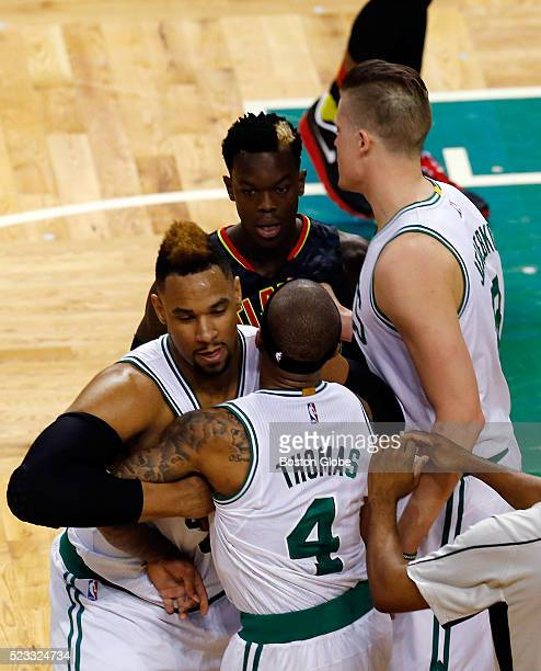 Boston Celtics guard Isaiah Thomas center is restrained by teammate Jared Sullinger as he exchanges words with Atlanta Hawks guard Dennis Schroder...