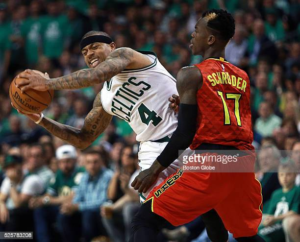 Boston Celtics guard Isaiah Thomas grimaces as he works against Atlanta Hawks guard Dennis Schroder in the second half of Game 6 in the first round...