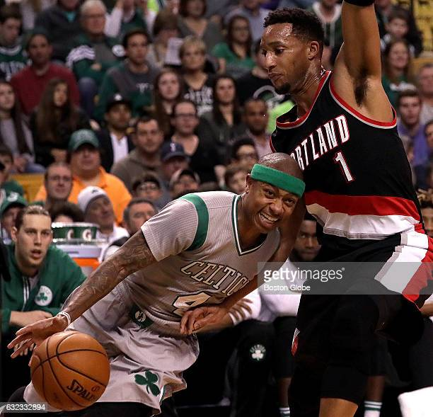 Boston Celtics guard Isaiah Thomas is defended by former teammate and current Portland Trail Blazers guard Evan Turner on this first quarter drive...