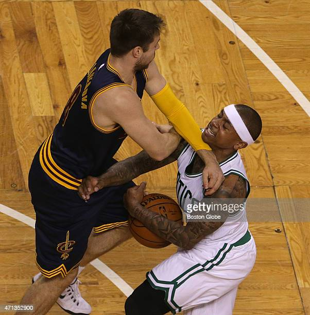Boston Celtics guard Isaiah Thomas is fouled by Cleveland Cavaliers guard Matthew Dellavedova as Thomas drove to the basket during the first quarter....