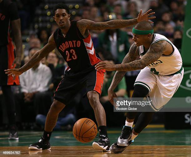 Boston Celtics guard Isaiah Thomas is nearly tripped up as he drove around Toronto Raptors guard Louis Williams in the second half The Boston Celtics...