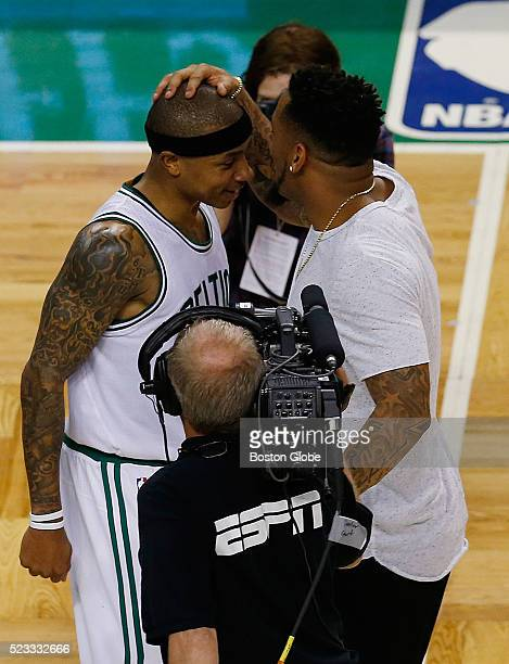 Boston Celtics guard Isaiah Thomas left is congratulated by New England Patriots player Patrick Chung right at the conclusion of Game 3 against the...