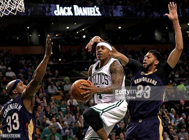 Boston Celtics guard Isaiah Thomas went up and under New Orleans Pelicans forward Anthony Davis for a 2 point layup during the second quarter The New...