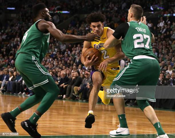 Boston Celtics guard Jaylen Brown and Boston Celtics forward Daniel Theis put the defensive squeeze on Los Angeles Lakers guard Lonzo Ball during the...