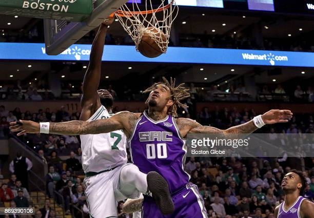 Boston Celtics guard Jaylen Brown throws down a dunk over Sacramento Kings center Willie CauleyStein during the first quarter The Boston Celtics host...
