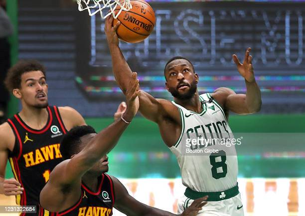 Boston Celtics guard Kemba Walker makes a third quarter layup over Atlanta Hawks center Clint Capela . The Boston Celtics host the Atlanta Hawks in a...