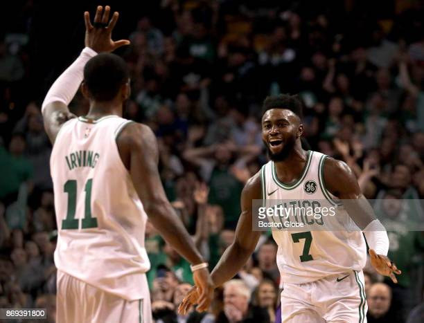 Boston Celtics guard Kyrie Irving and Celtics guard Jaylen Brown celebrate Brown's 26 foot three pointer on an assist by Irving for the 7854 lead...