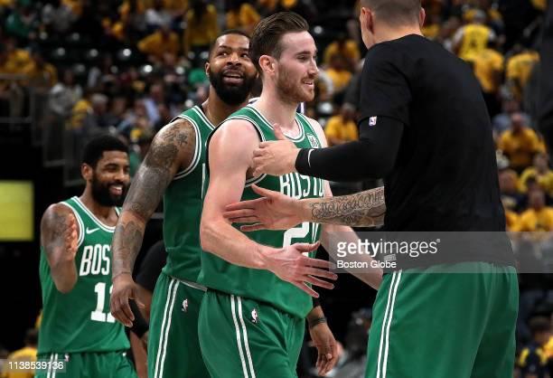 Boston Celtics guard Kyrie Irving Boston Celtics forward Marcus Morris and Boston Celtics forward Gordon Hayward are greeted by Boston Celtics...