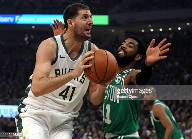 Boston Celtics guard Kyrie Irving defends Milwaukee Bucks forward Nikola Mirotic during the first quarter The Milwaukee Bucks host the Boston Celtics...