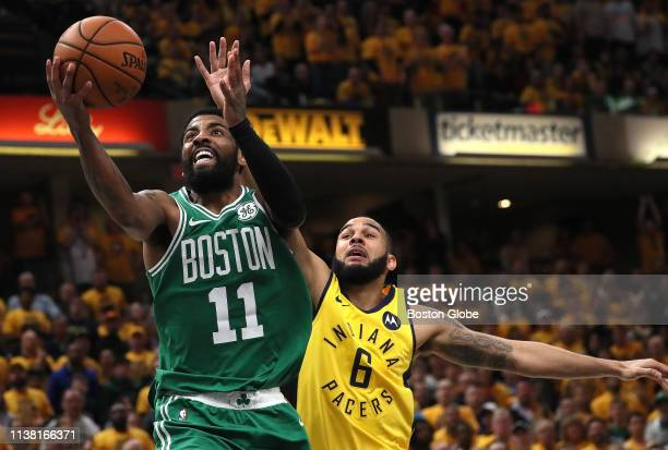 Boston Celtics guard Kyrie Irving drives past Indiana Pacers guard Cory Joseph for a layup during the fourth quarter The Indiana Pacers host the...