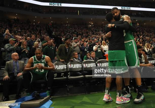 Boston Celtics guard Kyrie Irving is embraced by Boston Celtics forward Marcus Morris as time ran out on the Celtics as they fell 11691 to the...