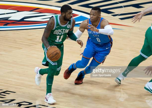 Boston Celtics Guard Kyrie Irving making letting the play develop while Oklahoma City Thunder Guard Russell Westbrook plays defense on November 03...