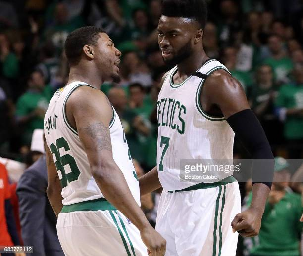 Boston Celtics guard Marcus Smart and Boston Celtics forward Jaylen Brown chest bump after Brown tied the game at 7272 during the third quarter The...