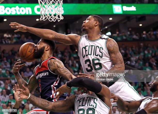 Boston Celtics guard Marcus Smart and the Celtics defense put the clamps on Washington Wizards forward Markieff Morris on this play during the third...