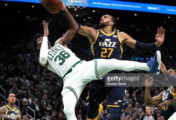Boston Celtics guard Marcus Smart is fouled by Utah Jazz center Rudy Gobert during the fourth quarter. The Boston Celtics host the Utah Jazz in a...