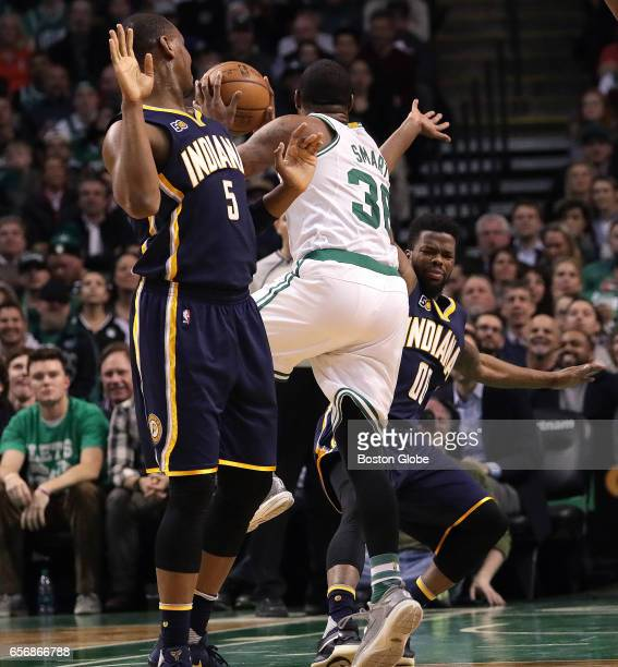 Boston Celtics guard Marcus Smart puts up an off balance shot as he is fouled by Indiana Pacers guard Aaron Brooks for the three point play to give...