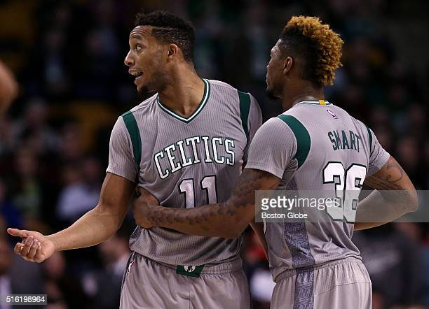 Boston Celtics guard Marcus Smart restrains Boston Celtics guard Evan Turner after Turner was assessed a technical foul with 008 left in the game...
