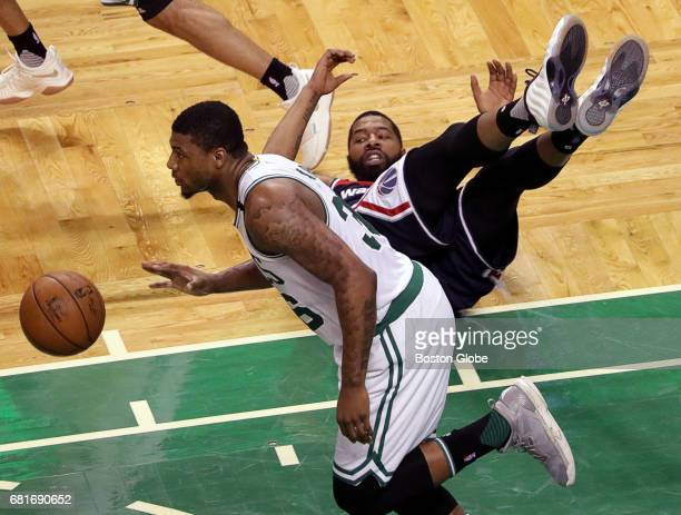 Boston Celtics guard Marcus Smart wins his battle for a loose ball with Washington Wizards forward Markieff Morris during the second quarter The...