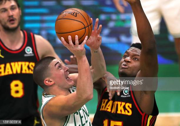 Boston Celtics guard Payton Pritchard makes two points in the fourth quarter, driving over Atlanta Hawks center Clint Capela . The Boston Celtics...