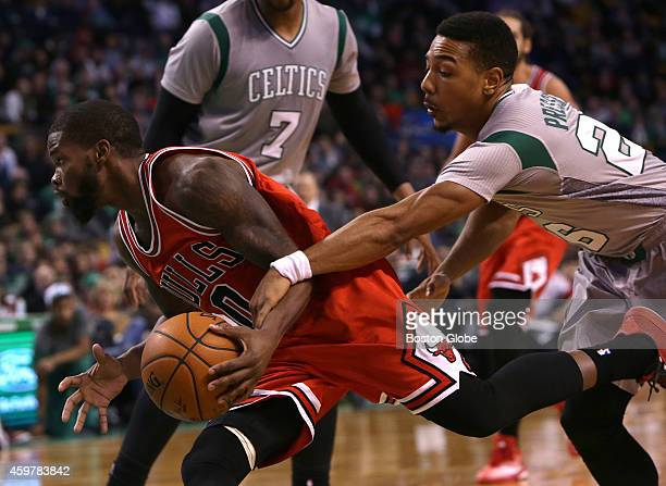 Boston Celtics guard Phil Pressey tries to slow down Chicago Bulls guard Aaron Brooks in the fourth quarter The Boston Celtics take on the Chicago...