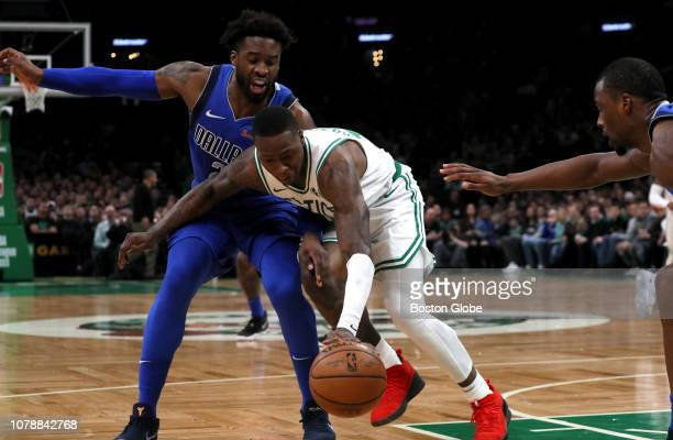 Boston Celtics guard Terry Rozier steals the ball from Dallas Mavericks guard Wesley Matthews during the first quarter The Boston Celtics host the...