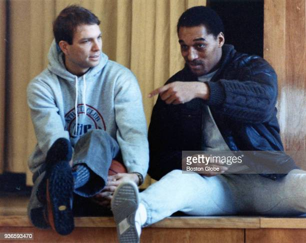 Boston Celtics guards Jerry Sichting left and Dennis Johnson right talk during practice in Boston Jan 11 1988