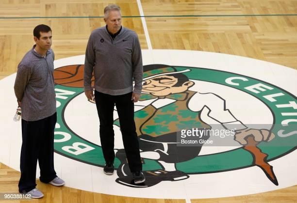 Boston Celtics head coach Brad Stevens, left, and Celtics general manager Danny Ainge watch as Jaylen Brown shoots during Boston Celtics practice in...