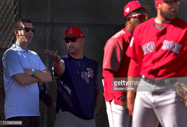 Boston Celtics head coach Brad Stevens left visits with Boston Red Sox manager Alex Cora during a spring training workout at JetBlue Park in Fort...