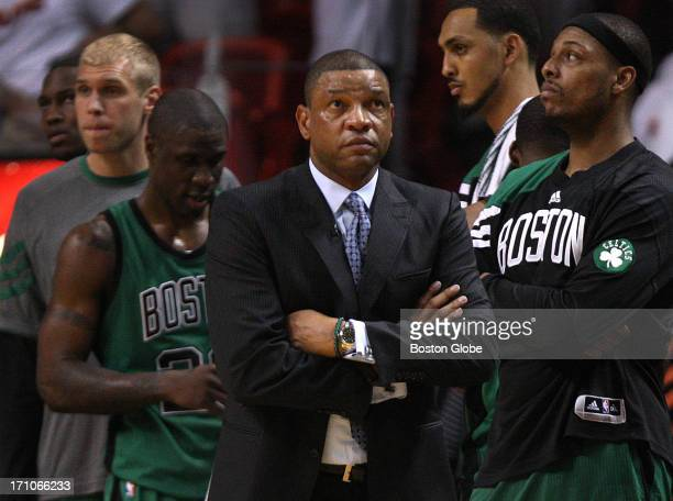 Boston Celtics head coach Doc Rivers and Boston Celtics small forward Paul Pierce watch as the clock wound down on any chances of a Celtics comeback...