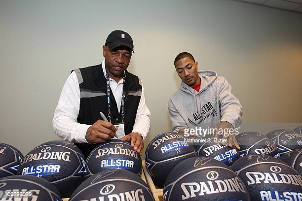 Boston Celtics head coach Doc Rivers and Derrick Rose of the Chicago Bulls autograph basketballs prior to the East West AllStar Practice on center...