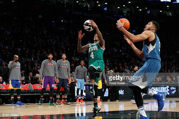 Boston Celtics Isaiah Thomas and Minnesota Timberwolves KarlAnthony Towns compete in the finals of the skills challenge at the NBA skills competition...