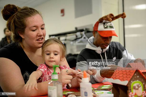 Boston Celtics Isaiah Thomas builds a ginger bread house with Isabella and Mom at Boston Children's Hospital on December 1 2016 in Boston...