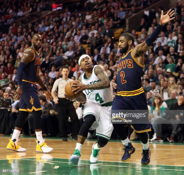 Boston Celtics' Isaiah Thomas drives to the basket on Cleveland Cavaliers' Kyrie Irving during the first quarter The Boston Celtics host the...
