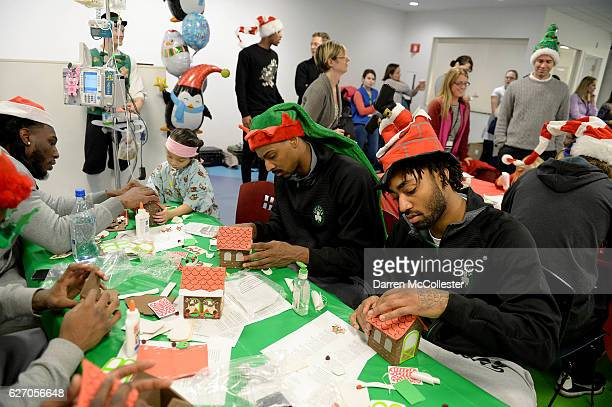 Boston Celtics Jae Crowder Mickey Jordan and James Young build ginger bread houses with Tiffany Boston Children's Hospital on December 1 2016 in...